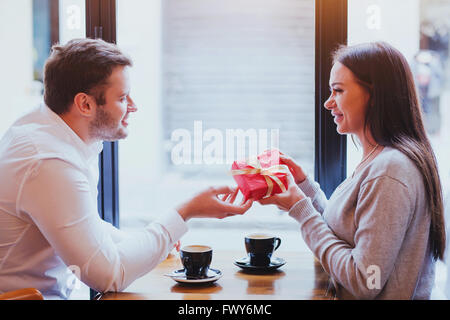 gift for valentines day, birthday or anniversary, man and woman in cafe, couple portrait - Stock Photo