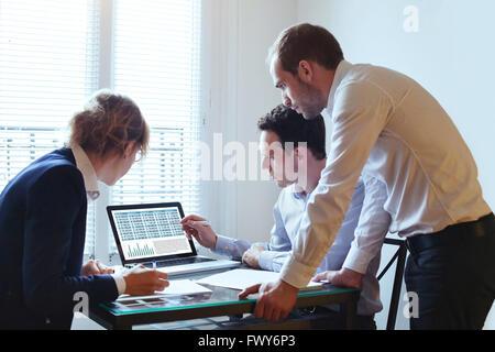 teamwork, business meeting, team working on financial plan - Stock Photo