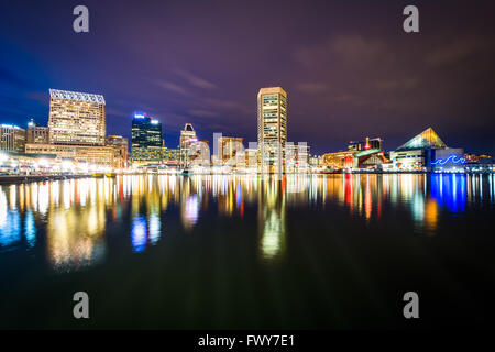 The Inner Harbor skyline at night, in Baltimore, Maryland. - Stock Photo