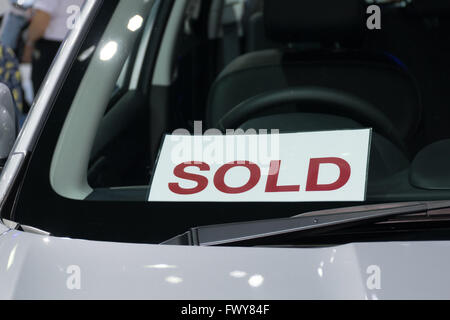 Sold label in the new car at car showroom - Stock Photo