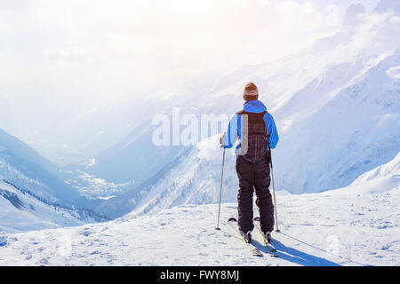 skiing in Alps, skier on beautiful mountain background at sunset - Stock Photo