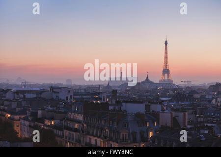 beautiful sunset view of illuminated Eiffel Tower and panorama of Paris, France - Stock Photo