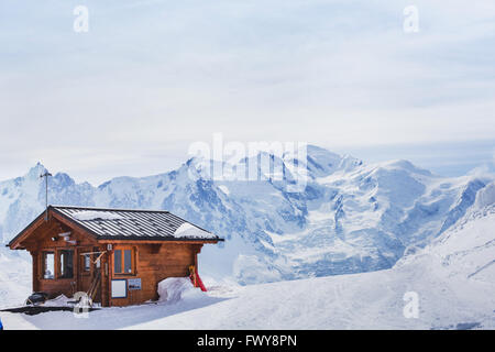 wooden house in winter mountains - Stock Photo