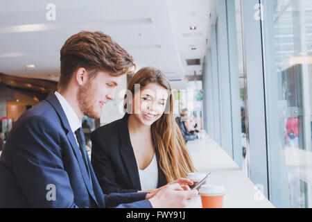 business people chatting in cafe at lunch or coffee break - Stock Photo