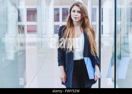 portrait of business woman looking at the camera - Stock Photo