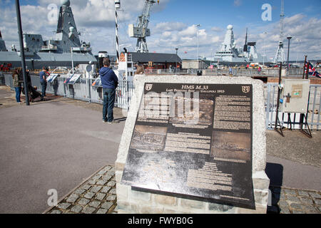 Plaque describing the history of HMS M33, an M29-class monitor of the Royal Navy built in 1915. - Stock Photo