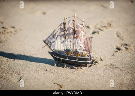 ship is a toy in the sand - Stock Photo