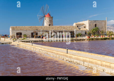Windmill in Culcasi saltworks, Natural Reserve of saltworks with salt marshes, Via del Sale, Salt Road, Nubia - Stock Photo