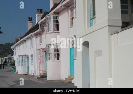 White and pink washed houses in Lyme Regis - Stock Photo