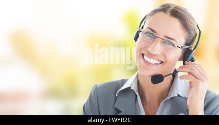 Composite image of portrait of a call center executive wearing headset - Stock Photo