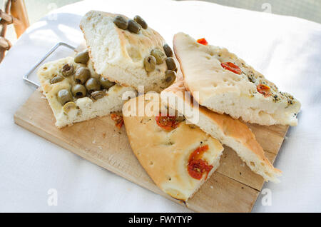 flatbread italy focaccia tomatoes olives focaccia flat oven baked Italian bread genovese ligure - Stock Photo