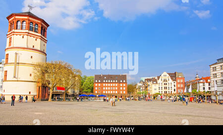 DUSSELDORF, GERMANY - MAY 3, 2013: Schiffahrtmuseum Schlossturm in the city center of Dusseldorf. Tourists nearby Stock Photo