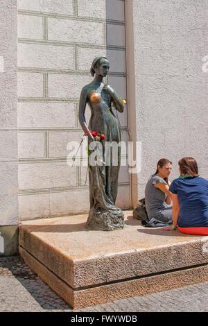 MUNICH, GERMANY - MAY 8, 2013: Juliet statue in Marienplatz near the Old City Hall in Munich in Germany. People - Stock Photo