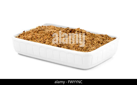Apple crumble in a white ceramic pan isolated on white background. - Stock Photo