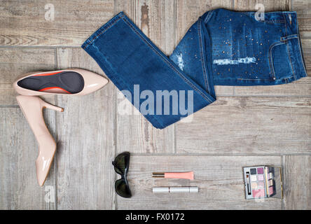 Flat lay picture of girl's jeans and accessories - Stock Photo
