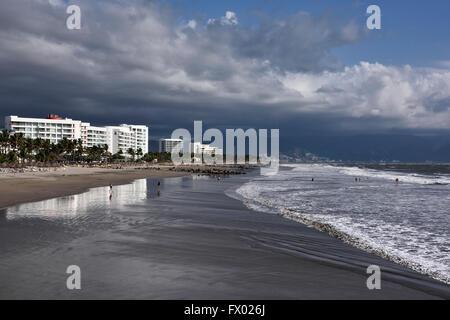 Tourists playing in wide beach of Nuevo Vallarta at Vidanta near Puerto Vallarta - Stock Photo