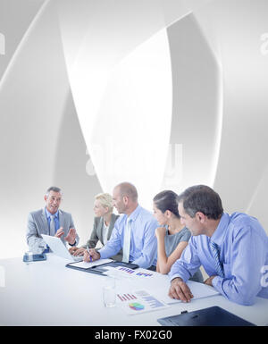 Composite image of business team having a meeting - Stock Photo