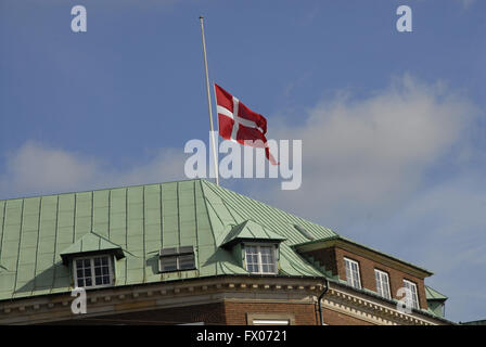 Copenhagen, Denmark. 09th Apr, 2016. Danish flags at half mast on all government and public buildings in the memory - Stock Photo