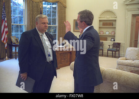 Washington, District of Columbia, USA. 31st Oct, 2001. United States President George W. Bush talks with Larry Lindsey, - Stock Photo
