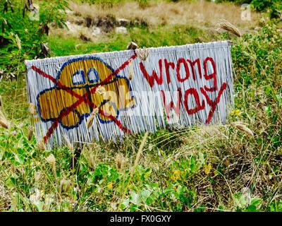 Handmade 'Wrong way' road sign - Stock Photo