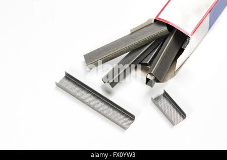 Stack of stapler's wires and paper box. - Stock Photo
