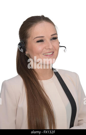 A friendly help desk employee in conversation using a head set - Stock Photo
