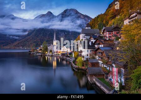 Hallstatt mountain village in fall during twilight, Salzkammergut, Austria - Stock Photo