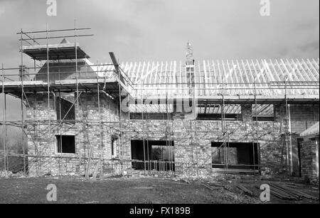 Very large new traditional style home being constructed in rural Somerset, 8th April 2016 - Stock Photo