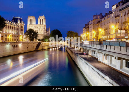 River Seine and Notre Dame by night, Paris France - Stock Photo