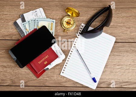 travel stuff on wooden table, top view - Stock Photo