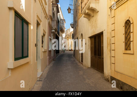 Narrow street in Victoria (Rabat) on Gozo, Malta. - Stock Photo