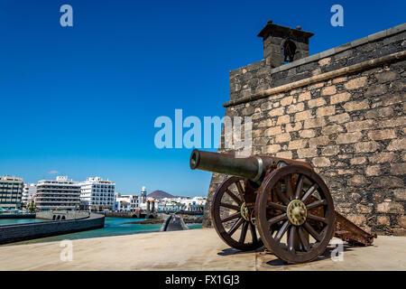 Castillo de San Gabriel - Saint Gabriel Castle in Arrecife and a cannon in front of it, Lanzarote island, Spain - Stock Photo
