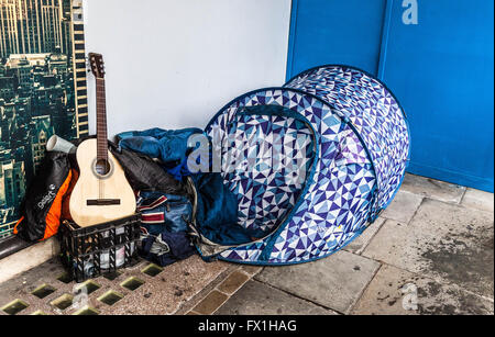 Homeless person sleeping rough in a tent on a pavement, Regent Street, London, England, UK - Stock Photo