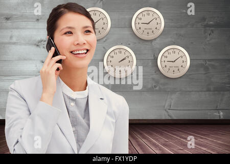 Composite image of close up of an businesswoman on phone - Stock Photo