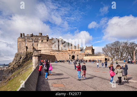 Tourists in the forecourt of Edinburgh Castle on a bright Spring day, Edinburgh, East Lothian, Scotland, UK - Stock Photo