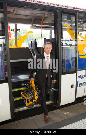 Businessman with folding bike on the bus - Stock Photo