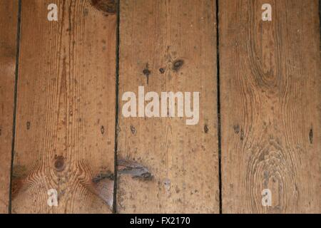 Close up of knotted old wooden floorboards horizontal - Stock Photo