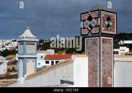 Pottery tiles on chimneys in  Salema on the Algarve , Portugal