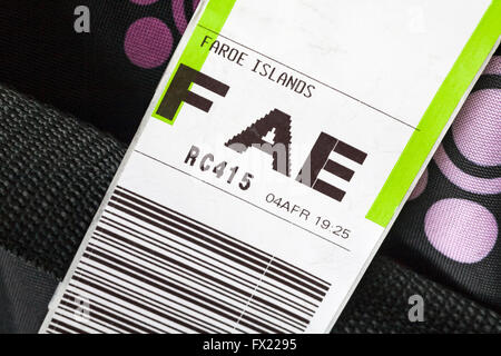 luggage label stuck on case for FAE Faroe Islands airport - Stock Photo