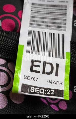 luggage label stuck on case for EDI Edinburgh airport - Stock Photo