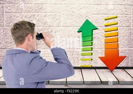 Composite image of businessman using binoculars - Stock Photo
