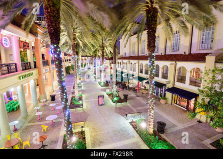 WEST PALM BEACH, FLORIDA - APRIL 3, 2016: Palm trees line CityPlace at night. The mixed-use  development was finished - Stock Photo