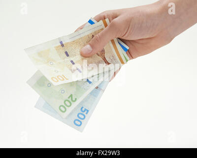 Closeup of a hand holding Danish currency - Stock Photo