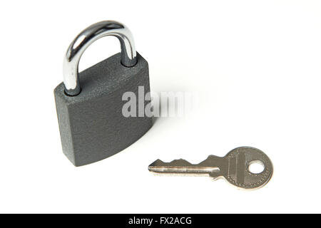 Padlock with key next to it on a white background - Stock Photo