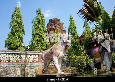 A tiger statue and an elephant statue carrying people are displayed at a Buddhist Temple in Tboung Khmum Province, - Stock Photo