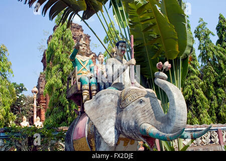 An elephant statue carrying people is displayed at a Buddhist Temple in Tboung Khmum Province, Cambodia. - Stock Photo