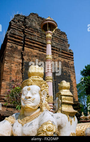 Gold Buddha statues are displayed near a stupa at a Buddhist Temple in Tboung Khmum Province, Cambodia. - Stock Photo