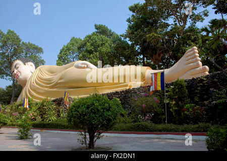 A large reclining Buddha is displayed at a Buddhist Temple in Tboung Khmum Province, Cambodia. - Stock Photo