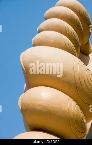 The feet and toes of a large reclining Buddha are displayed at a Buddhist Temple in Tboung Khmum Province, Cambodia. - Stock Photo