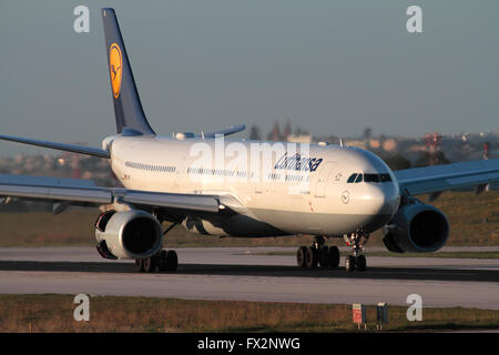 Civil aviation. Lufthansa Airbus A330-300 on arrival in Malta at sunset - Stock Photo